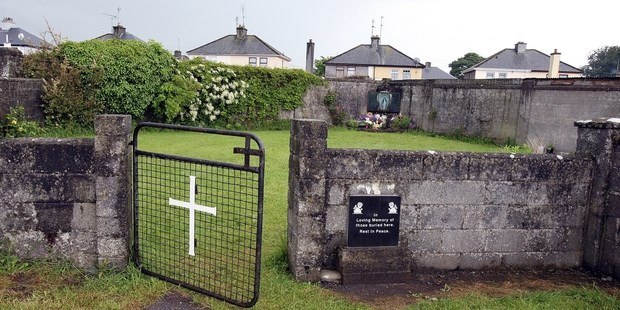 This picture shows a shrine in Tuam, County Galway on June 9, 2014, erected in memory of up to 800 children who were allegedly buried at the site of the former home for unmarried mothers run by nuns.  Up to 800 babies and children were buried in a mass grave in Ireland near a home for unmarried mothers run by nuns, new research showed, throwing more light on the Irish Catholic Church's troubled past.  Death records suggest 796 children, from newborns to eight-year-olds, were deposited in a grave near a Catholic-run home for unmarried mothers during the 35 years it operated from 1925 to 1961.  AFP PHOTO/PAUL FAITH