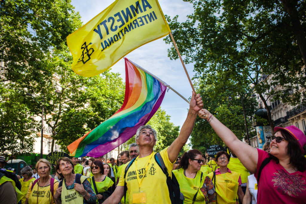 Amnesty International activists take part in Gay Pride in Paris, 27June 2015