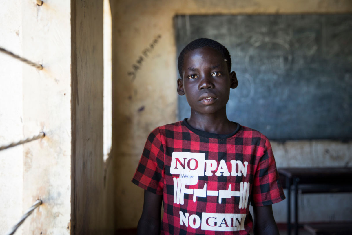 William 11, from South Sudan, seen here at Mogadishu School, in the Kakuma refugee camp, Northern Kenya, 19 August 2016. I was born here in Kakuma, but I know we had a lot in Sudan. We had 3 houses one for cattle, a shed and one that we lived in. My sister died in South Sudan and I have another sister here in Kakuma. I like living here because if we go to South Sudan there is war. I like football, I play a lot. When I'm older I like to work so that I can help my mother and father. My father was shot in his left leg. I would like to have any work so that I can help my parents.