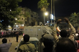Demonstrators and security forces outside the presidential palace, Cairo, Egypt, December 2012.