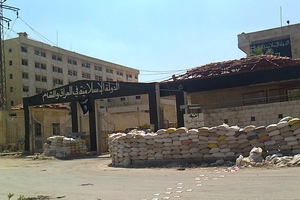 185134_The_Shari_a_Commission_with_an_ISIS_sign_next_to_the_ISIS_headquarter_in_Qadi_Askar_Aleppo_Syria. (1) medium