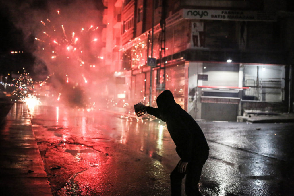 Turkey Kurdish millitant fires fireworks towards Turkish riot police