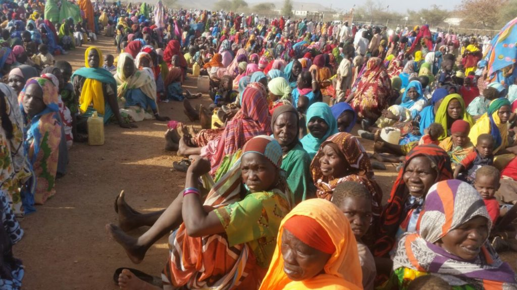 PEOPLE DISPLACED BY VIOLENCE IN NORTHERN JEBEL MARRA IN JANUARY AND FEBRUARY 2016, GATHER AROUND THE UNAMID BASE IN SORTONI, DARFUR.  Photograph provided by third party sources who met with survivors of attacks.