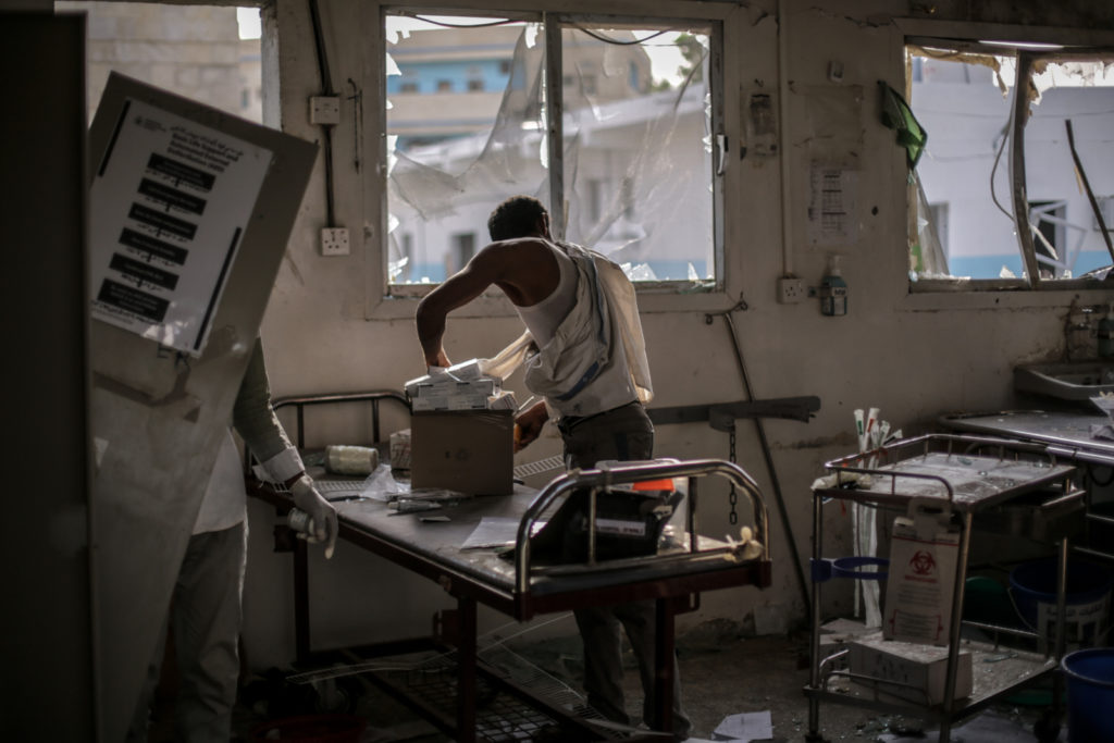 Hospital workers salvage the remains of undamaged medication and equipment left in the emergency room. In a country where access to health care is poor at best, the Abs Rural Hospital was the only facility catering to over 2000 internally displaced people locally and thousands more along the coast, from the north-western border to the outskirts of Hodeidah. Now, the closest hospital is over 3 hours away.