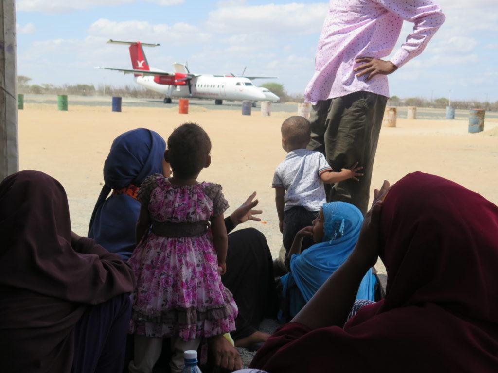 Somali refugees in Dadaab wait to board a plane to Somalia's capital, Mogadishu.