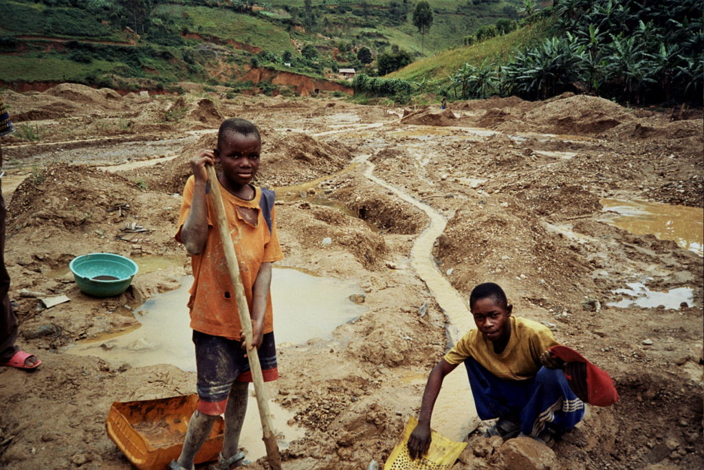 Children working in the Twangiza gold fields, South Kivu, eastern DRC, April 2009. Thousands of children - many of them orphans or former child soldiers - work in eastern DRC's artisanal mines.  Mining is considered one of the Worst Forms of Child Labour according to international standards.