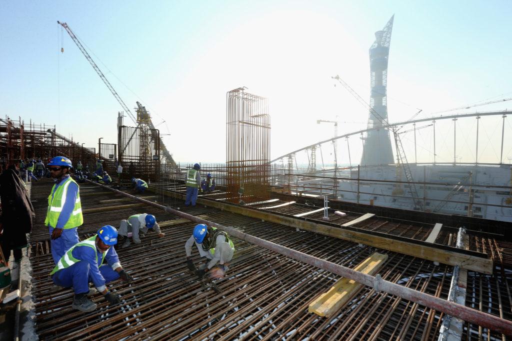 DOHA, QATAR - DECEMBER 30:  Construction workers on Khalifa International Stadium ahead of the 2022 FIFA World Cup Qatar on December 30, 2015 in Doha, Qatar.  (Photo by Warren Little/Getty Images)