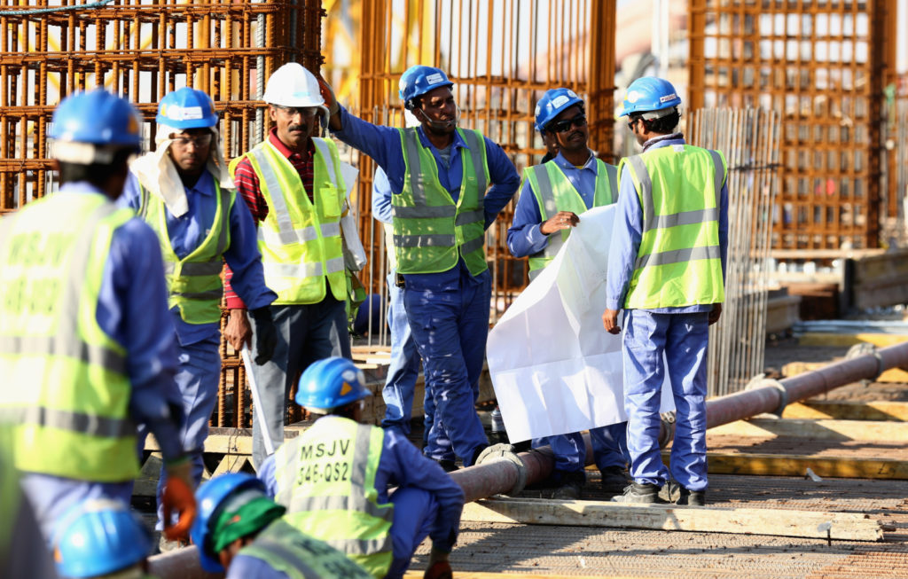 DOHA, QATAR - DECEMBER 30:  Construction workers on Khalifa International Stadium ahead of the 2022 FIFA World Cup Qatar on December 30, 2015 in Doha, Qatar.  (Photo by Warren Little/Getty Images)