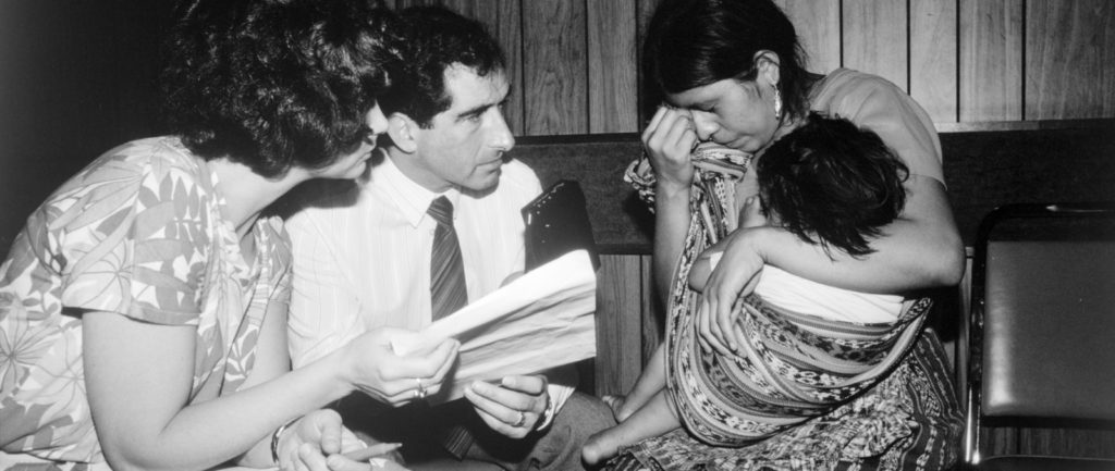 Amnesty International mission delegates (Tracy Ulveit Moe and Nigel Rodley) interview a woman re the disappearance of her husband, Hotel Camero Real, Guatemala, April 1985.