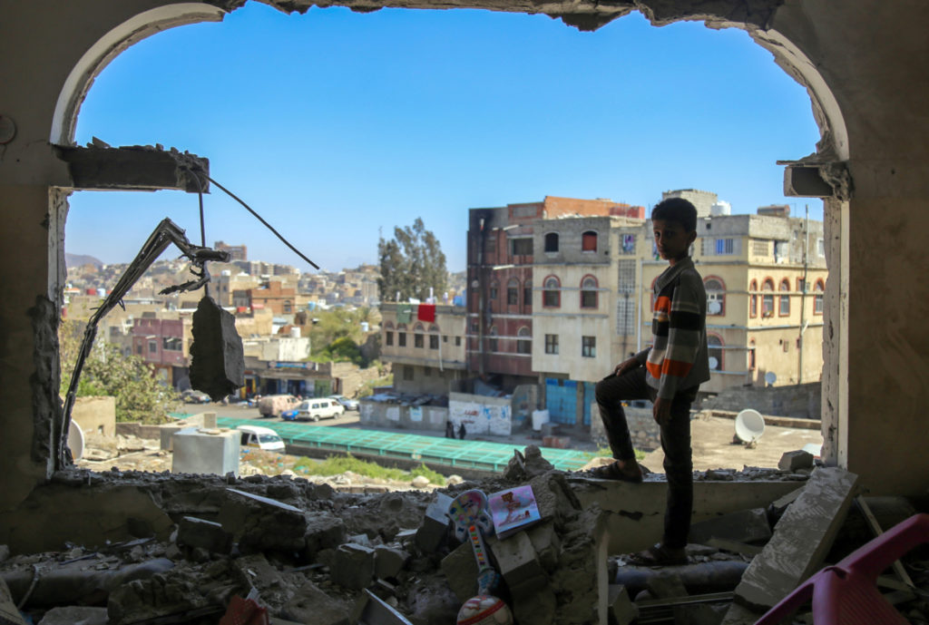 TOPSHOT - A Yemeni boy checks the damage following a mortar shell attack on the country's flashpoint southern city of Taez on February 3, 2016, as clashes between fighters from the Popular Resistance Committees, loyal to Yemen's fugitive President and Shiite Huthi rebels continue. The city of Taez is held by loyalists of Yemen's internationally recognised government, but it has been besieged by the Iran-backed rebels for months. Abedrabbo Mansour Hadi loyalists backed by a Saudi-led coalition have fought back and have been trying to retake Taez province and pave the way towards the rebel-held capital. © AHMAD AL-BASHA/AFP/Getty Images
