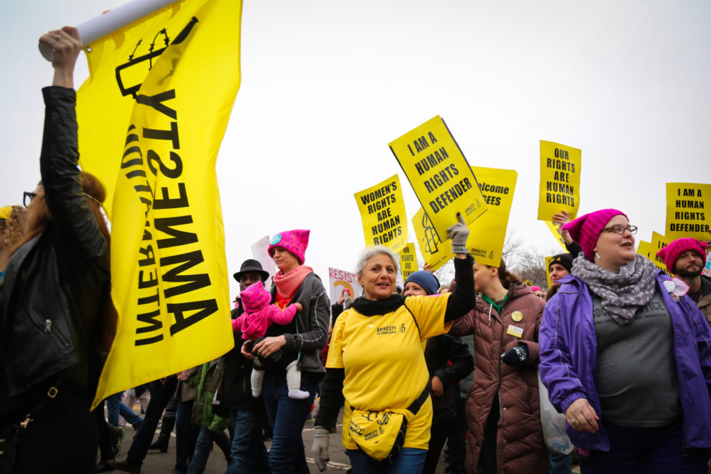 Amnesty members and supporters join the women's march in Washington DC, 21 January, 2017.