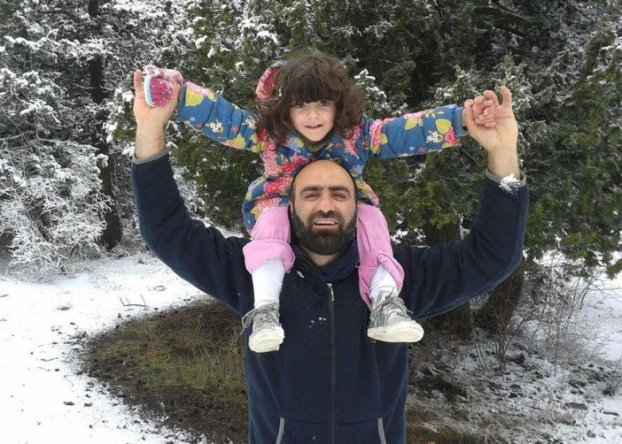 Ahmed and one of his daughters in 2016