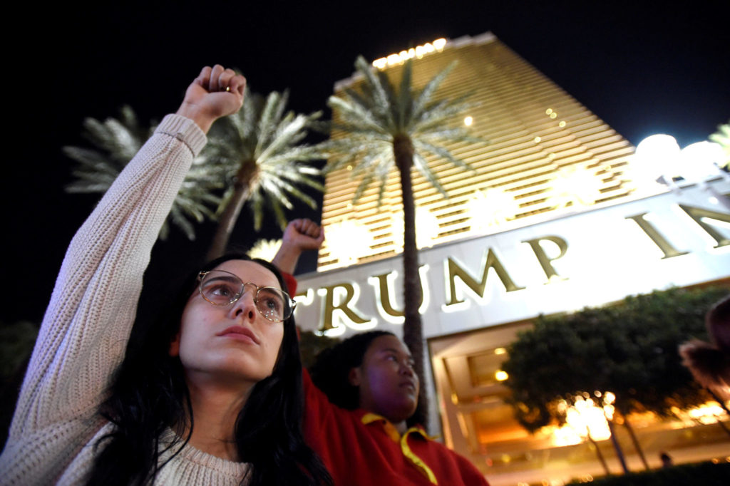 H8JCMW Demonstrators chant in protest against the election of Republican Donald Trump as President of the United States, at the Trump International Hotel & Tower in Las Vegas, Nevada, U.S. November12, 2016.  REUTERS/David Becker     TPX IMAGES OF THE DAY