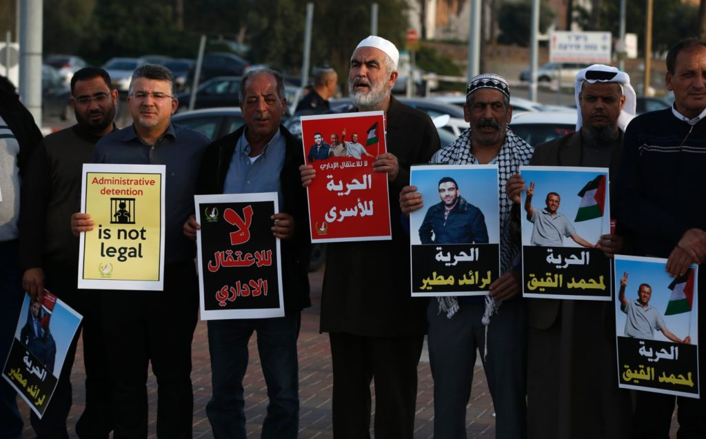 Arab-Israeli Sheikh Raed Salah (C), the leader of the radical northern wing of the Islamic Movement in Israel, takes part in a demonstration against administrative detention and in support of Palestinians prisoners Mohammed al-Qiq and Jamal Abu Leil and Raed Mteir (portraits) outside the Ayalon prison in Ramle, near Tel Aviv, on February 27, 2017. / AFP / AHMAD GHARABLI        (Photo credit should read AHMAD GHARABLI/AFP/Getty Images)