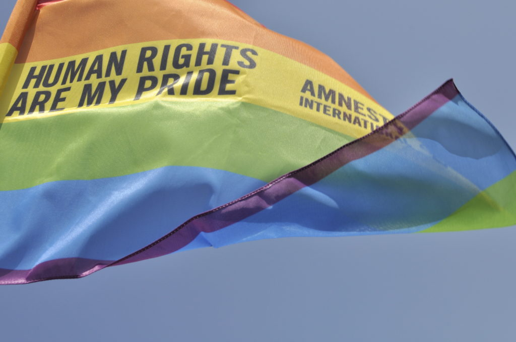 Rainbow flag in Palermo Pride, 22th June 2013.  Gay pride flag waving in the breeze with the words, Amnesty International - Human Rights are my Pride.