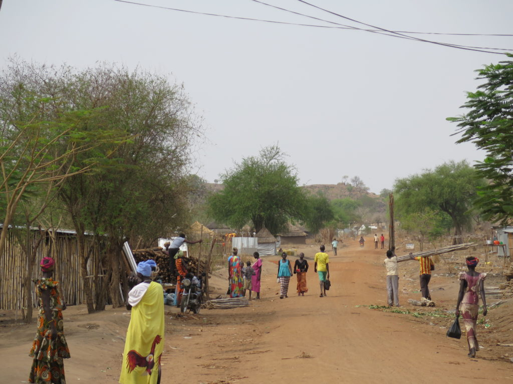 The main road on the outskirts of Nyumanzi refugee settlement in northern Uganda. There are over 900,000 South Sudanese refugees in Uganda. Severe funding shortfalls have meant basic needs are not being met.