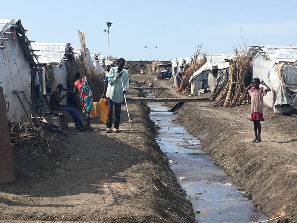 Few Shilluk IDP people (including children) in the UN Protection of Civilians (PoC) site in Malakal, in the Upper Nile region (South Sudan)