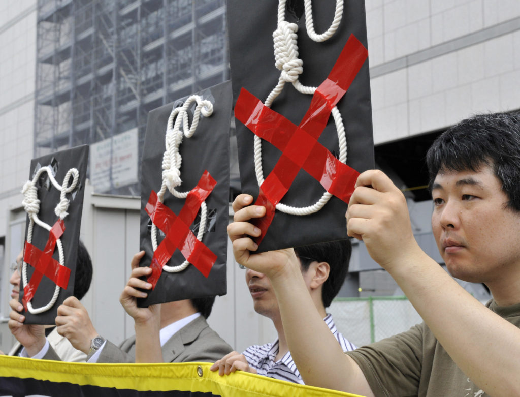Members of Amnesty International hold a rally to protest against Japan's death penalty in front of the national Diet in Tokyo on July 28, 2009. Japan has hanged three inmates convicted of multiple murders including a Chinese national and a middle-aged man who found his victims through an Internet suicide site. The government identified the condemned as Hiroshi Maeue, 40, Yukio Yamaji, 25, and Chinese national Chen Detong, 41, who had killed three of his compatriots and wounded three more Chinese people. AFP PHOTO / Yoshikazu TSUNO (Photo credit should read YOSHIKAZU TSUNO/AFP/Getty Images)