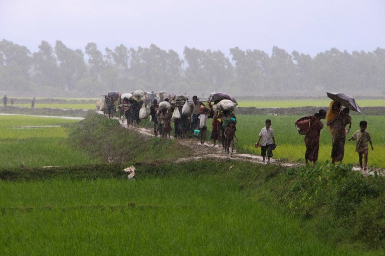 Rohingya refugees from Rakhine state in Myanmar walk along a path near Teknaf in Bangladesh on September 2, 2017. Around 400 people -- most of them Rohingya Muslims -- have died in violence searing through Myanmar's Rakhine state, the army chief's office said on September 1, with tens of thousands forced to flee across the border into Bangladesh. A further 20,000 Rohingya have massed along the Bangladeshi frontier, barred from entering the South Asian country, while scores of desperate people have drowned attempting to cross the Naf, a border river, in makeshift boats.  / AFP PHOTO / Suzauddin RUBEL        (Photo credit should read SUZAUDDIN RUBEL/AFP/Getty Images)