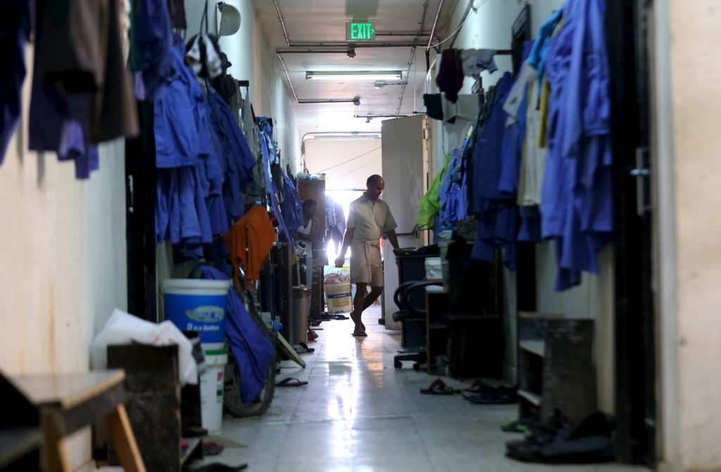 A labourer is pictured in a foreign workers dormitory in the Sanaya Industrial Area in Doha, during a government-guided tour, May 3, 2015. The Qatari government on Sunday conducted the tour of four foreign workers' dormitories, including two newly built by the government, to show their living conditions. REUTERS/Stringer - RTX1BDBB