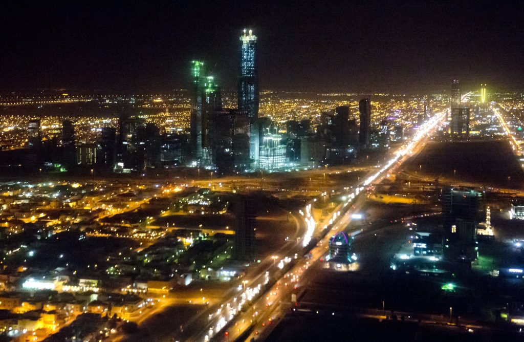 The skyline of Riyadh, Saudi Arabia, March 28, 2014, is seen at night in this aerial photograph from a helicopter. AFP PHOTO / Saul LOEB        (Photo credit should read SAUL LOEB/AFP/Getty Images)