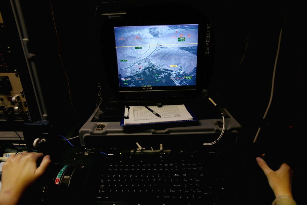 KANDAHAR, AFGHANISTAN - MAY 2, 2006: The US military in Kandahar, southern Afghanistan, a Taliban stronghold, are using high-tech Predator drones against their enemy. They have approximately 8 there. The Predator has no pilot, and is controlled for his highly secret mission from Las Vegas. The team in Kandahar is in charge of their take off and landings. The drones have a highly powerful camera with infrared, as well as a still camera and two missiles. (Photo by Veronique de Viguerie/Getty Images)