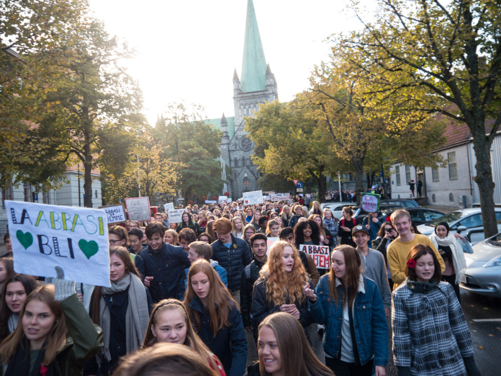 "A demonstration in Trondheim, Norway's third largest city, on 3 October 2017. Organised by a group of high school students, it saw over 1,000 people pour into the main city square to protest against the government's threat to deport their 18-year-old classmate, Taibeh Abbasi, and her family to Afghanistan. Some of the placards read ""From love and peace to an unknown place"", ""They are already home"" and ""Go down to Afghanistan yourself and see how safe it is""."