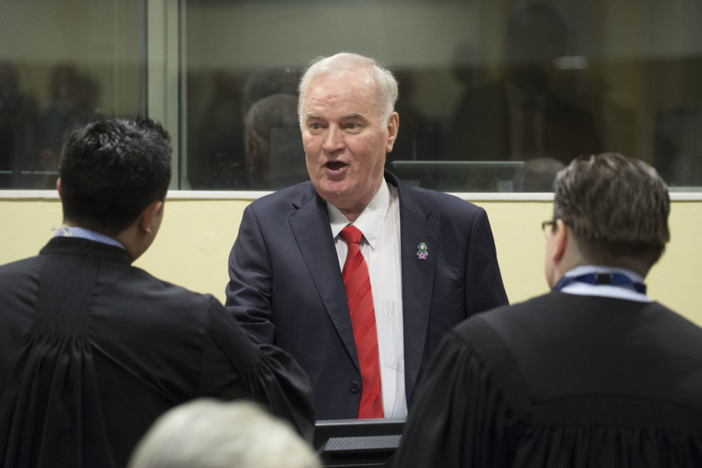 "THE HAGUE, NETHERLANDS - NOVEMBER 22: Former Bosnian military chief Ratko Mladic speaks to his lawyers before appearing for the pronouncement of the Trial Judgement for the International Criminal Tribunal for the former Yugoslavia (ICTY) on November 22, 2017 in The Hague, The Netherlands. UN war crimes judges at The Hague are expected to deliver a verdict on Bosnian Serb military commander Ratko Mladic, dubbed the ""Butcher of Bosnia"" today. Mladic, 74, is accused of 11 counts - which include genocide, war crimes and crimes against humanity committed by his forces during the war in Bosnia from 1992 and 1995. (Photo by Michel Porro/Getty Images)"