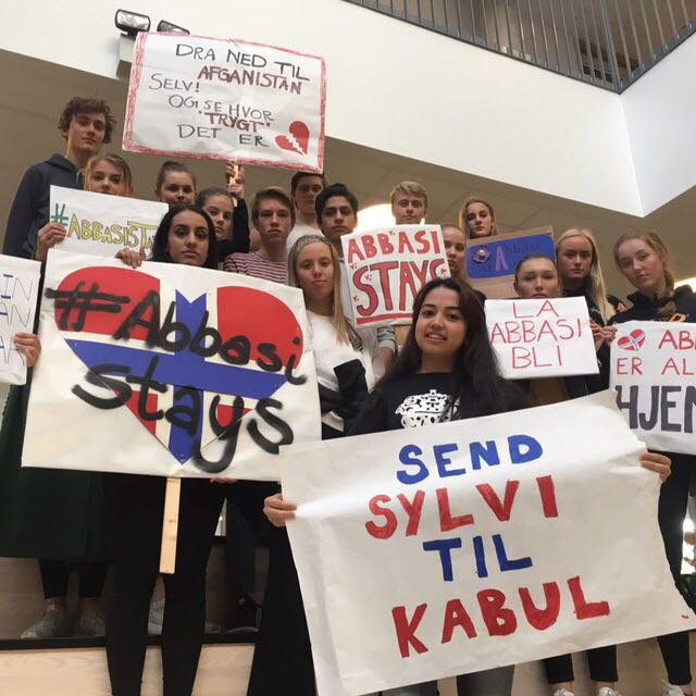 "Student Council leader Mona Elfareh (front, left), Afghan asylum-seeker Taibeh Abbasi and fellow students at Thora Storm high school in Trondheim, Norway, with signs created for a demonstration they organised in Trondheim, Norway's third largest city, on 3 October 2017. It saw over 1,000 people pour into the main city square to protest against the government's threat to deport their 18-year-old classmate, Taibeh Abbasi, and her family to Afghanistan. ""Send Sylvi to Kabul"" reads one of the signs, referring to Norway's Migration and Integration Minister, Sylvi Listhaug."