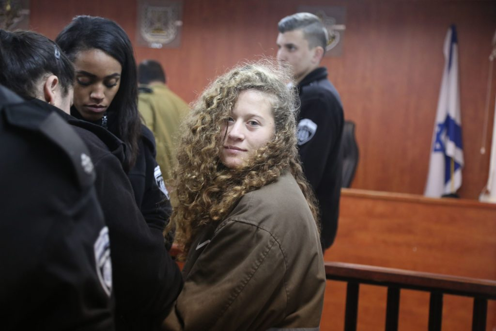 """RAMALLAH, WEST BANK - JANUARY 01: The 16-year-old Palestinian Ahed al-Tamimi (R), who was awarded the """"Hanzala Award for Courage"""" in Turkey, appears in court after she was taken into custody by Israeli soldiers, at Ofer Military Court in Ramallah, West Bank on January 01, 2018. (Photo by Issam Rimawi/Anadolu Agency/Getty Images)"""