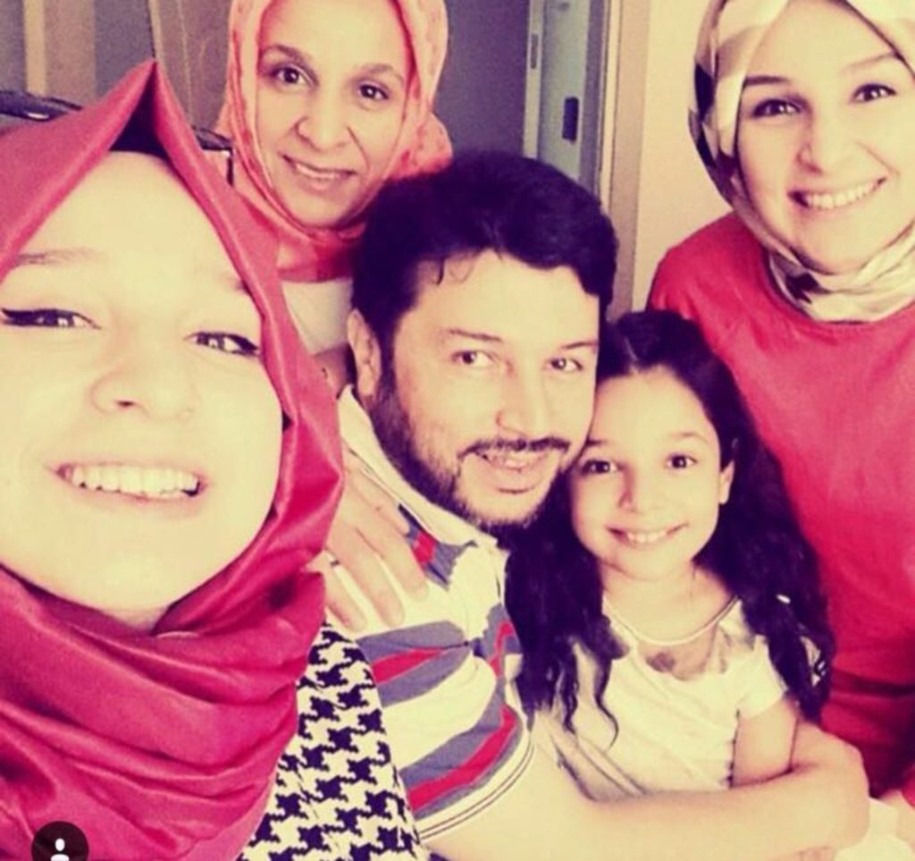 """Taner Kilic with his daughters and wife Taner Kılıç, the Chair of Amnesty International Turkey, is charged with """"membership of the Fethullah Gülen Terrorist Organization"""". This charge is based on the allegation that he downloaded and used the ByLock messaging application, claimed to have been used by the Gülen movement to communicate. However, two independent forensic analyses of Taner's phone commissioned by Amnesty International found that there is no trace of ByLock having been on his phone."""