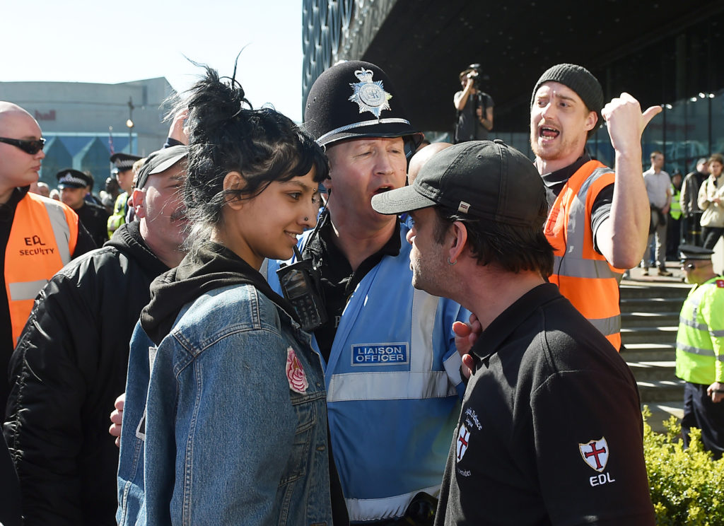 Review of the Year 2017: April: Saffiyah Khan (left) faces down English Defence League (EDL) protester Ian Crossland during a demonstration in the city of Birmingham, in the wake of the Westminster terror attack.