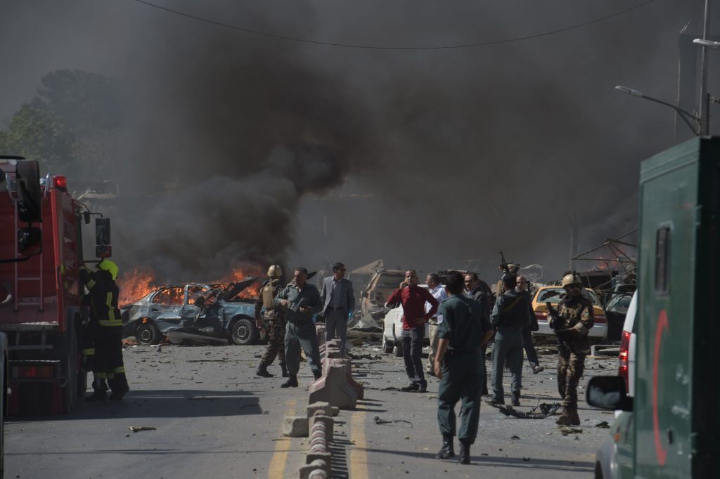 TOPSHOT - Afghan security forces arrive at the site of a car bomb attack in Kabul on May 31, 2017. At least 40 people were killed or wounded on May 31 as a massive blast ripped through Kabul's diplomatic quarter, shattering the morning rush hour and bringing carnage to the streets of the Afghan capital. / AFP PHOTO / SHAH MARAI        (Photo credit should read SHAH MARAI/AFP/Getty Images)