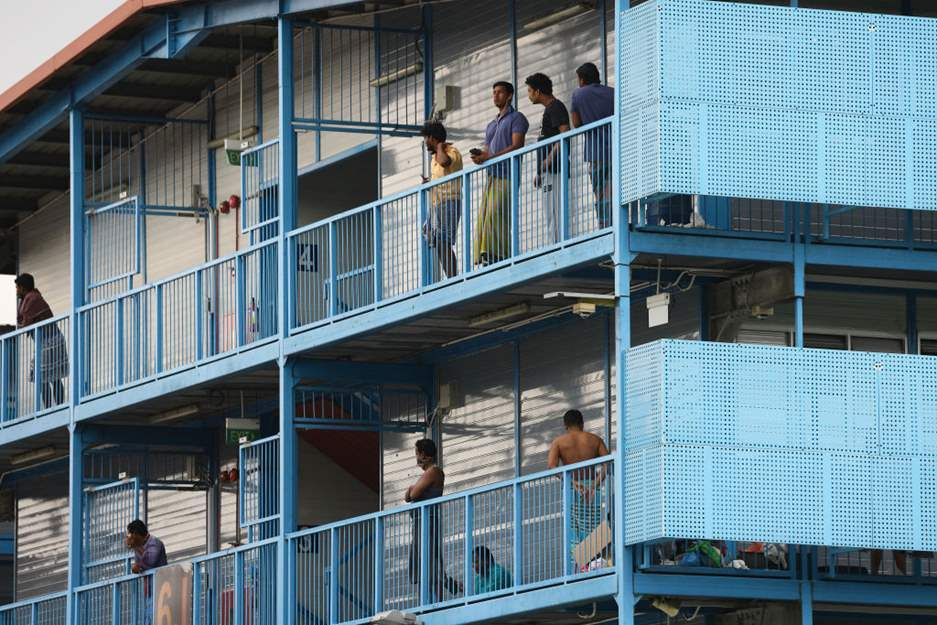 Singapore: Over 20,000 migrant workers in quarantine must be protected from mass infection
